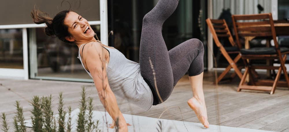 laughing woman doing a funny Yoga pose